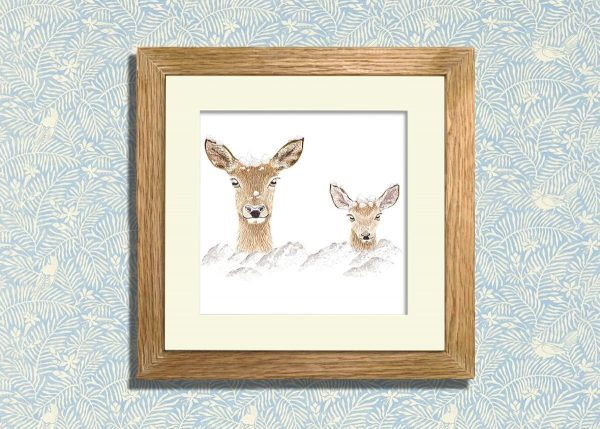 Two deer in the snow. Greetings card in an oak frame.